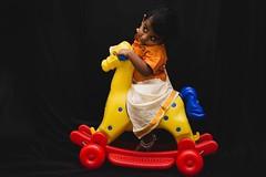 Shy (Karunyaraj) Tags: cute look blackbackground play photoshoot shy cuteness fullframe fx jaden saddle shyness childplay nikon24120 goldendress traditionalwear yongnou nikond610 yongnou568