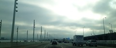 Commute (AAcerbo) Tags: california cars clouds oakland driving widescreen overcast baybridge cropped commuting iphone throughthewindshield iphoneography