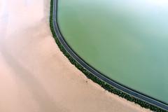 Green lagoon (Roger Ellison) Tags: green sand westkirby westkirbymarinelake