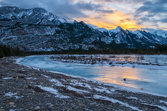 Morning Light (Quincey Deters) Tags: morning winter cloud mountain snow canada ice nature rock horizontal sunrise river landscape dawn jasper outdoor january shore alberta northamerica allrightsreserved jaspernationalpark 2015 canadianrockymountains leadingline colourimage snaringriver quinceydeters