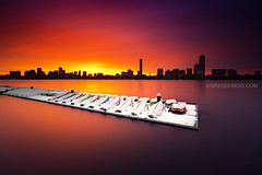 Boston Skyline Sunrise over Charles River and Snow Covered Boats from Cambridge Massachusetts USA (Greg DuBois - Sponsored by LEE Filters) Tags: city longexposure morning winter cambridge sky urban usa snow seascape cold reflection water silhouette boston skyline clouds sunrise canon river boats photography dawn early photo colorful downtown sailing cityscape photographer unitedstates cloudy photos snowy massachusetts charlesriver smooth newengland surreal wideangle stormy wallart posters prints waterblur sailboats northeast backbay hancocktower eastcoast memorialdrive overturned bostonskyline waterscape 6d boatdock stockphotography johnhancocktower prudentialtower northatlantic sailingcenter skylinesilhouette mitsailingpavilion leefilters bostonsunrise bigstopper gregdubois