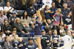 Cheerleader Elevated During BYU Basketball Game (aaronrhawkins) Tags: game college basketball stand uniform university crowd skirt cheer cheerleader elevated pompoms modest motivate raise byu elevate brighamyounguniversity collegecheerleader marriotcenter aaronhawkins byucheerleader