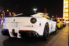 Ferrari F12berlinetta Novitec Rosso (R_Simmerman Photography) Tags: winter white black by club marina mall hotel design dubai boulevard walk garage united parking main uae entrance ferrari emirates khalifa arab saudi arabia kuwait rearlights abu dhabi tuning rosso qatar burj supercars valet combo smoked 2014 jbr sportcars novitec bydesign dubaicars hypercars carsofdubai f12berlinetta