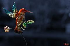Humming Bird Garden Ornament (MBates Foto) Tags: nature outdoors washington spokane gardening pacificnorthwest northamerica stockimage 99203 hummingbirdgardenornament