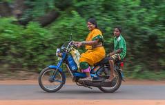 Rider in the storm (suv.sehgal) Tags: boy bike lady happy pondicherry auroville puducherry