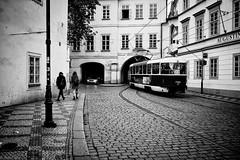 Transportation (michael.mu) Tags: leica blackandwhite bw car 35mm walking czech prague streetphotography tram praha transportation streetcar malstrana m240 leicasummicron35mmf20asph silverefexpro leicasummicronm1235mmasph