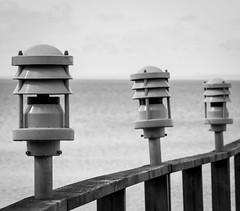 Varamon Bridge Lanterns (JohanKampe) Tags: wood bridge sky bw beach water strand outside outdoors blackwhite sweden steel structures bridges himmel structure sverige bro railing railings vatten motala stl broar tr svartvitt utomhus rcke varamon rcken byggnationer