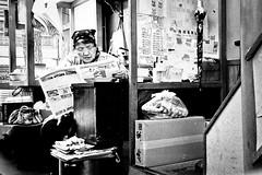 Woman reading, Kyoto (electricnerve) Tags: portrait blackandwhite film japan reading newspaper kyoto mju candid interior room zuiko claustrophobia environmentalportrait neopanss fujineopanss olympusmjui