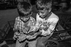 H504_3131-3 (bandashing) Tags: street friends england bw boys monochrome night work children manchester friendship eat labour nightlife nut cart sylhet bangladesh socialdocumentary childlabour paan betel mouthful aoa supari bandashing akhtarowaisahmed