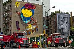 Murals & Dump Trucks (Joel Raskin) Tags: city nyc newyorkcity streetart eastvillage les buildings lumix workers construction mural manhattan lowereastside streetscene 2ndavenue 2ndave osgemeos dumptrucks 1ststreet fz1000
