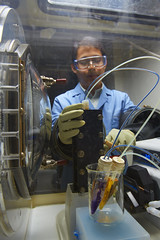 Researcher with Test Battery (Pacific Northwest National Laboratory - PNNL) Tags: battery doe electrolyte departmentofenergy pnnl pacificnorthwestnationallaboratory
