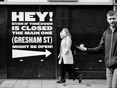 Hey! Pointing is Rude! (Feldore) Tags: street ireland irish man sign poster candid olympus belfast panasonic arrow moment northern pointing mchugh decisive timing em1 35100mm feldore
