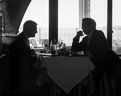 """What are we gonna do about this guy Trump?"" (John St John Photography) Tags: newyorkcity blackandwhite bw newyork silhouette lunch restaurant political streetphotography drinks talking trump thebattery twoguys candidphotography"