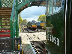 Loco D8729 (37029) approaches North Weald Station, passing 45132 to the righthandside and approaching D8059 (20059) in the immediate foreground. Epping Ongar Railway Spring Diesel Gala. 24 04 2016 (pnb511) Tags: heritage train footbridge engine railway loco trains locomotive lattice class37 diesels class20 class45 eppingongarrailway northwealdstation