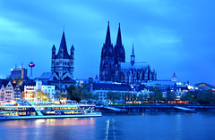 Cologne in Blue (manuelecant) Tags: panorama water clouds river germany landscape lights europe towers cologne bluehour rhine hdr klnerdom