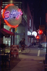 Solly's Bagels (Orion Alexis) Tags: street film sign shop night vancouver analog 35mm store neon bagel fujifilm analogue 135 cinematic sollys tx1 800t cinestill