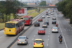 TransMilenio buses near the Simon Bolivar station (World Bank Photo Collection) Tags: city urban bus cars latinamerica buses car truck highway colombia bogot transport vehicles motorbike transportation freeway infrastructure motorcycle vehicle trucks worldbank lanes