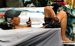 Saigon Chinatown (Clemens Kubenka) Tags: travel tourism bike mobile work chinatown break phone market cell vietnam business smartphone chi motorcycle rest worker leisure lon ho pause minh saigon cho cholon hochiminhcitiy