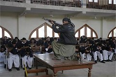 Peshawar : A Pakistani security official poses as a militant during a security drill at the Islamia College in wake of the militants' attack on the Bacha Khan University which left many dead (legend_news) Tags: college dead during official university wake many attack security peshawar pakistani khan left militant which poses drill militants bacha a islamia