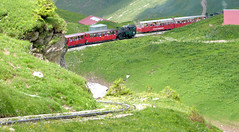 Brienz Rothorn Bahn - Locomotive No. 6 built by SLM in 1933 with two of the older coaches passes one of the modern steam locomotives at Planalp Station on the 9th July 2012 (trained_4_life) Tags: switzerland brienz brb berneseoberland cograilway brienzrothornbahn rackrailway planalp
