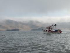 Fishing Boat off of Callao, Peru (Craigs Travels) Tags: ocean fog clouds island fishingboat shrouded callao