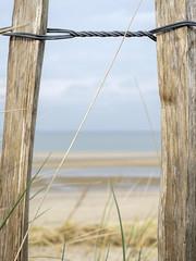 Untitled (Wouter de Bruijn) Tags: wood beach nature grass metal fence landscape coast wire sand post bokeh outdoor depthoffield fujifilm xt1 fujinonxf35mmf14r