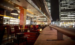 Wall of Wharf Street (ludderz) Tags: light colour reflection building london glass night canon buildings reflections dark underground photography lights restaurant colours angle wide seats wharf after cropped canary colourful rule dlr hdr thirds