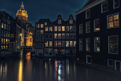 Amsterdam Floating Houses (angheloflores) Tags: travel bridge houses windows sky urban holland water netherlands colors amsterdam architecture night clouds lights canal cityscape floating explore refelctions