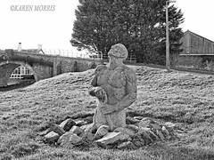 #40 Coming Out Of The Ground (116 Pictures In 2016) (kazmorris) Tags: blackandwhite canal sculptures leedsliverpool halsall navvies 116picturesin2016