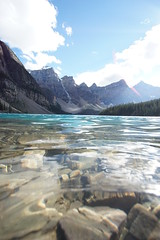 Base of Moraine Lake (ryan.kole32) Tags: travel trees lake snow canada nature water beauty clouds forest landscape rockies outdoors nationalpark pov perspective bluesky alberta banff rockymountains moraine banffnationalpark morainelake canadianrockies banffalberta beautyinnature