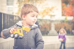 Playground fun (doranyiro) Tags: autumn boy fall smile fashion playground yellow kids canon children fun happy kid eyes child play outdoor pastel matte