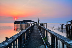Piai Serenity (zollatiff) Tags: ocean morning sunset seascape reflection nature colors sunrise landscape twilight scenery jetty structures peaceful malaysia seashore tranquil johor waterscape beachscape tanjungpiai fishermenvillage leegndfilter nikkor1024 nikond7100 zollatiff