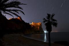 Cala Moraig (binladiya) Tags: sky lighthouse beach night reflections stars faro mar long exposure mediterraneo playa palmeras alicante cielo estrellas nocturna cala mediterraneansea reflejos javea largaexposición xabia moraig