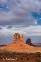 Chasing Shadows (TreeRose Photography) Tags: light sunset shadow red sky clouds utah rocks stormy monumentvalley rockformations themittens