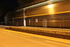 Capitol Corridor Past the Searchlights (ScholzRUNNER) Tags: california railroad usa night canon nightshot trains amtrak unionpacific davis railfan capitolcorridor uprr f59 emd amtrakstation f59phi unionpacificrailroad amtrakcalifornia railroadphotography buildingamerica usatrains amtrakamerica