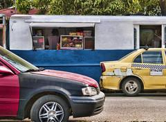 Primary subtractive colours (Giorgio Verdiani) Tags: auto road street blue red slr cars yellow shop digital america strada zoom blu digitale wheels olympus via giallo panama rosso streetfood zuiko panamacity centralamerica 2012 8mp trafic automobili evolt ruote e500 fourthirds 40150mm americacentrale quattroterzi