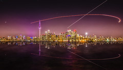 Tracing its path - Explored! (jrobblee) Tags: city longexposure toronto ontario canada reflection water night canon landscape eos cityscape nightscape lighttrail 70d efs1018mm