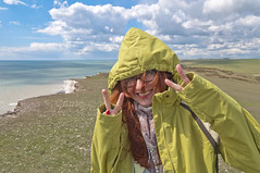 At the edge of the world (Vladimir Yaitskiy) Tags: park uk sea woman nature water girl smile smiling clouds outdoors happy glasses brighton wind unitedkingdom exploring explorer windy victory cliffs redhead edge eastbourne redhair redheaded englishchannel beachyhead edgeoftheworld sevensisterspark