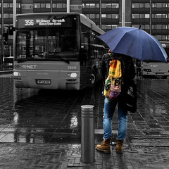 Paraplu (zsnajorrah) Tags: urban motion reflection bus haarlem netherlands rain umbrella candid text transportation concours selectivecolour stationsplein iphonese