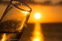 Goodbye to Nevis (judethedude73) Tags: sunset sea summer sky orange water glass silhouette evening coast skies dusk champagne coastal cheers rays