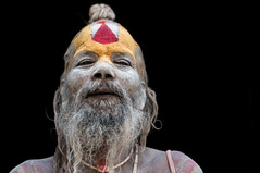 Sadhu Series, Four (Axel Halbgebauer) Tags: street travel nepal red portrait people india white color yellow closeup zeiss beard prime eyes pov head sony perspective streetphotography wideangle headshot kathmandu sadhu holyman southasia saarc sonyalpha streetportait sonyimages distagon3514za sonya7r2