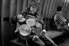 Drumming man (feldmanrick) Tags: sanfrancisco street blackandwhite bw monochrome fuji streetphotography fujifilm marketstreet unposed decisivemoment rickfeldman