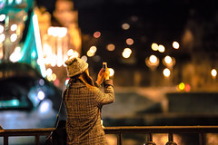 Taking photos at night (Vagelis Pikoulas) Tags: bridge winter light woman girl night canon liberty lights europe hungary bokeh budapest january tamron vc f28 6d 70200mm 2016