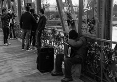 Padlocked moments (carlosromonbanogon) Tags: street bridge friends bw musician music white black sleep frankfurt snapshot samsung amateur padlock steg eiserner nx10