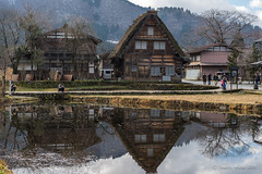 Shirakawa-go reflection and photographers (NettyA) Tags: travel houses roof winter house reflection water japan pond asia village thatch unescoworldheritage shirakawago shirakawa gassho 2015 gasshostyle ogimachi gifuprefecture onodistrict