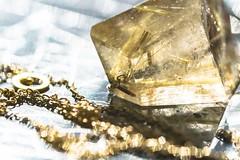 Fly me to the moon (Tracey Rennie) Tags: sun sunlight macro gold crystal jewelry jewellery quartz pendant rutilatedquartz astraltravel macromondays rosannepugliese