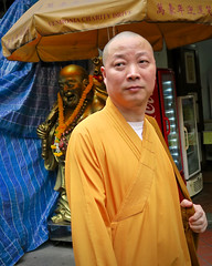 Chinatown Monk (Mondmann) Tags: man statue walking asian singapore asia southeastasia chinatown buddha buddhist religion streetphotography monk passing buddhistmonk buddhastatue mondmann canonpowershotg7x