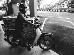 newspaper delivery (KHarrisN) Tags: life street camera blackandwhite monochrome lumix citylife panasonic malaysia kuantan pahang compact pagi lightroom surat 2016 lynas khabar gritstreet gelagatmanusia