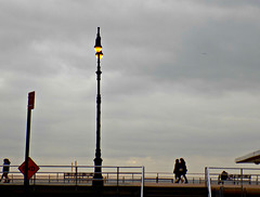 Boardwalk Winter Stroll (Robert S. Photography) Tags: wood winter sky people signs color beach brooklyn clouds vintage coneyisland lights nikon scenery scene lamppost coolpix boardwalk lit february benches brightonbeach strolling 2016 iso80 ls340
