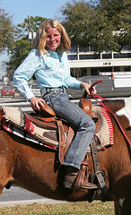 Cowgirl Poses (wyojones) Tags: horse cute girl beautiful beauty pretty texas boots houston parade jacket blonde cowgirl lovely bluejeans saddle trailride houstonlivestockshowandrodeo stirrups saddlehorn wyojones houstonlivestockandrodeoparade